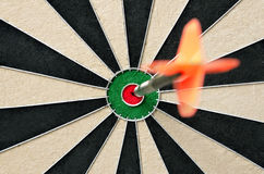 Dart in bulls eye Stock Photography