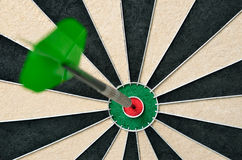 Dart in bulls eye Stock Images