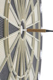 Dart in bulls eye of dartboard Stock Photo