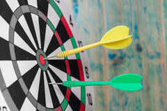 Dart on the center of dartboard Stock Images