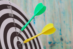 Dart on the center of dartboard Royalty Free Stock Photography