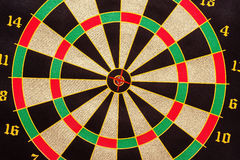 Dart in the center of dartboard Stock Photo