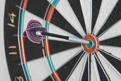 Dart in centre of dartboard. One dart in the centre of the dartboard Royalty Free Stock Photos