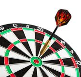 Dart closeup. Dart board with colour dart isolated on white background stock photo