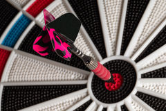 Dart with Copy Space on Tail. Dart in the bullseye with room on the tail for your copy.  Personalized Royalty Free Stock Photos