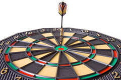 Dart in dartboard. On white background Royalty Free Stock Images