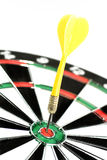 Dart in a dartboard. (hitting the bullseye Royalty Free Stock Images
