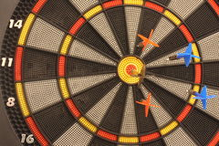 Dart and dartboard. Only one can win, only one hit the target royalty free stock photos