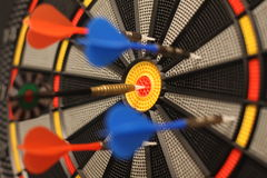 Dart and dartboard. Only one can win, only one hit the target stock photo