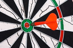 Dart and dartboard Stock Images