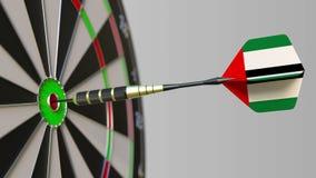 Dart featuring flag of the United Arab Emirates UAE hits bullseye of the target. Sports or political success related. Dart featuring flag hitting bullseye of the stock video