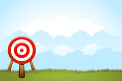 Dart on the Field. Vector illustration of a dart as a target standing on the field with cloud background. Available copy space for your text Stock Photography
