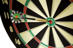 Dart game. An arrow game with a dart has hit the mark Stock Photo