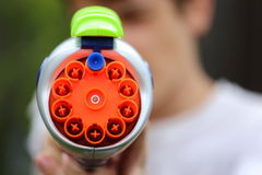 Dart Gun. Close up view of a plastic multicolored dart gun Royalty Free Stock Photography