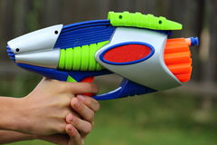Dart Gun. Close up view of a plastic multicolored dart gun Stock Photos