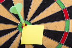 Dart hit the centre of target Stock Images