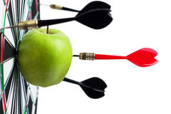 Dart hit green apple Stock Images
