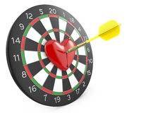 Dart hit the heart in the center of dartboad Stock Image