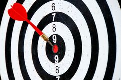Dart hit in the middle. On red point Royalty Free Stock Photos