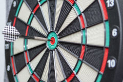 The dart hits the dartboard center Stock Photography