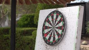 The dart hits the darts in slow motion and knocks out 7 points.