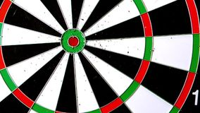 Dart hitting the board stock footage
