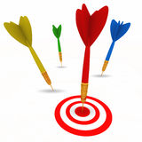 Dart hitting bullseye target successfully Stock Photo