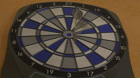 Dart hitting bullseyes on dartboard, great aim stock video