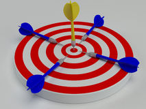 Dart hitting center target on dartboard Stock Images
