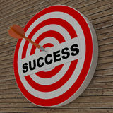 Dart hitting success center target on dartboard Stock Images