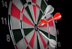 Dart hitting a target Royalty Free Stock Photos