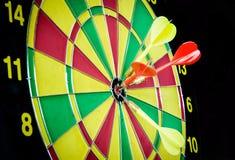 Dart hitting a target Stock Image
