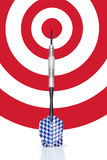 Dart Leaning On A Target Stock Photo