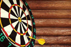 Dart missed the center of the target Darts. Mistake and error Royalty Free Stock Photography