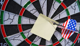 Dart and note Stock Photos