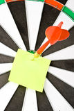 Dart and note Royalty Free Stock Image