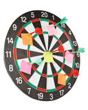Dart and note. On a dartboard. Close up royalty free stock photos