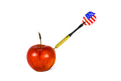 Dart piercing an apple Royalty Free Stock Photography