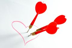 Dart in red heart Royalty Free Stock Image