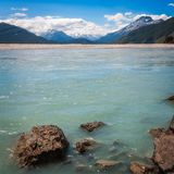 Alpine scenery from Dart River in New Zealand. Dart River view with snow-capped mountains in the background at Isengard Lookout a very remote location on Kinloch Royalty Free Stock Images