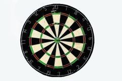 Dart strikes the bulls-eye of a dartboard Royalty Free Stock Photo