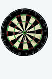 Dart strikes the bulls eye of a dartboard Stock Photos