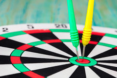 Dart stuck in a board Royalty Free Stock Photography