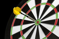 Dart stuck in a dartboard Stock Photography