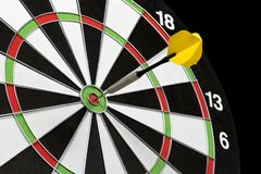Dart stuck in a dartboard Stock Image