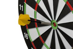 Dart stuck in a dartboard Stock Photo