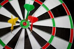 Dart stuck in a dartboard Stock Images
