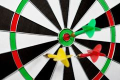 Dart stuck in a dartboard Stock Photos
