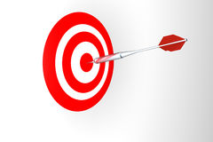 Dart in target. 3d dart in red and white target Stock Photo