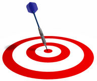 Dart on target. A dart hit the dead center of the target, isolated on white Royalty Free Stock Images